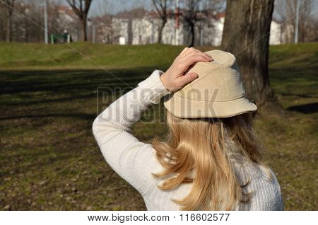 Woman In Park On Windy Day