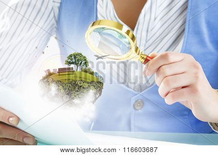 Person using magnifier for exploration