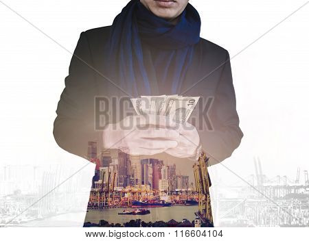Double exposure, businessman holding cash with cityscape, abstract concept