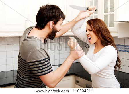 Young couple arguing in the kitchen.