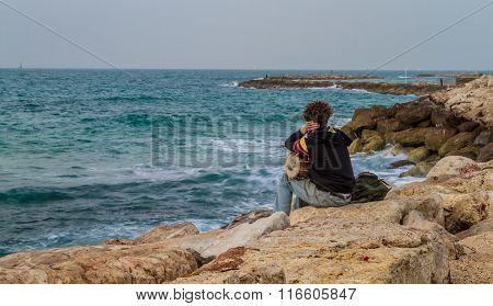 Young Man Looking At Mediterranean Sea In Tel Aviv