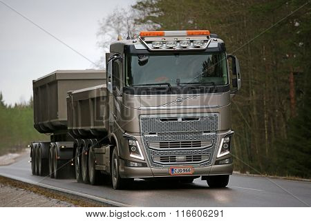 Bronze Volvo FH16 Combination Truck On The Road