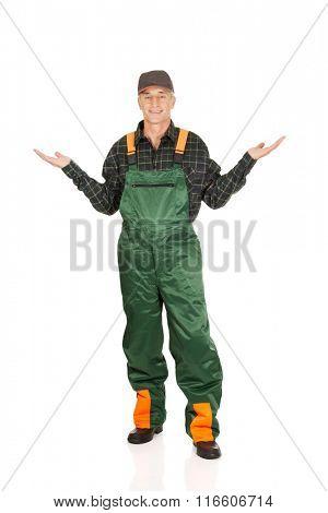 Gardener in uniform showing space with both hands