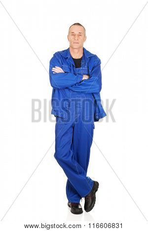 Smiling repairman with folded arms
