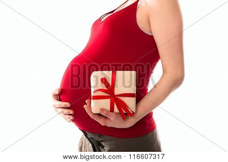 Belly Pregnant Woman In Red T-shirt With A Gift In The Hands