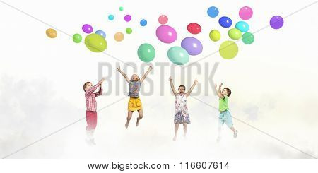 Playful children catch balloons