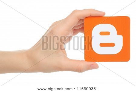 Hand holds Blogger logotype