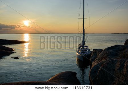 Sunset Over Sailboat Moored Long Side A Small Rocky Island