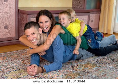 family lying on the floor