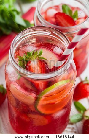 Preparation homemade refreshing  strawberry,lime and rhubarb lemonade with mint