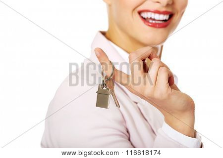 Business woman real estate agent holding keys