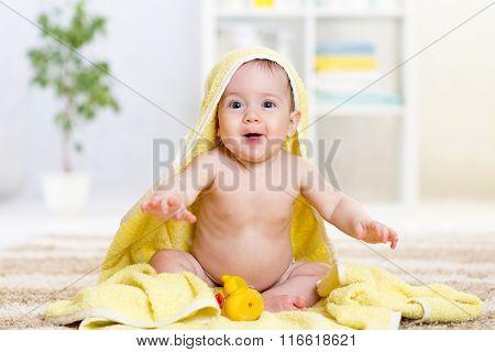 happy baby in towel indoor