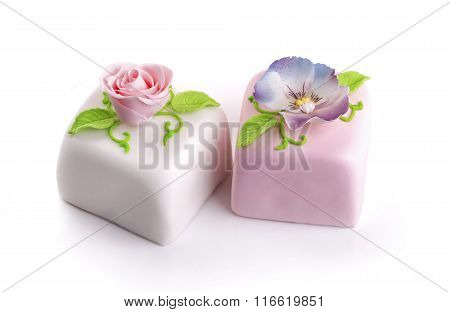 Two Beautiful Decorated Marzipan Cakes Isolated On White