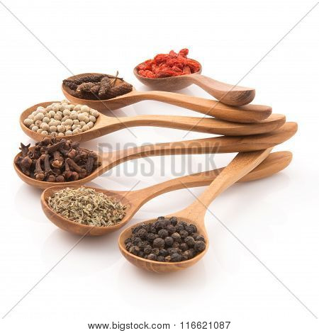 Spicy Herb Insert A Wooden Spoon Arranged To Prepare Food On A White Background.