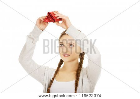 Young unhappy woman with empty purse.