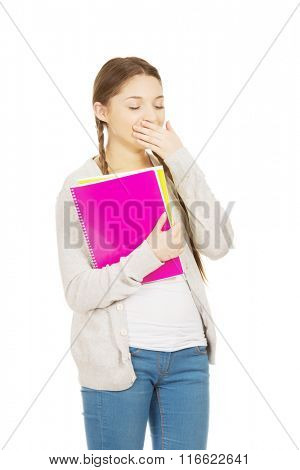 Bored teen woman with notebook.