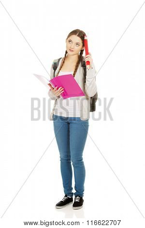 Thoughtful student woman with big pencil.
