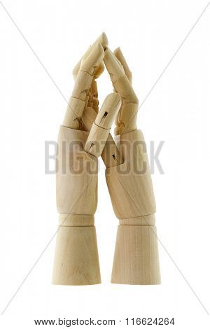 Wooden hands in light color holding palms together, isolated on white