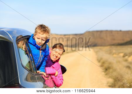 mother and son travel by car in mountains
