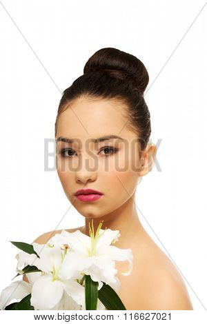 Beauty face of a woman with flower.