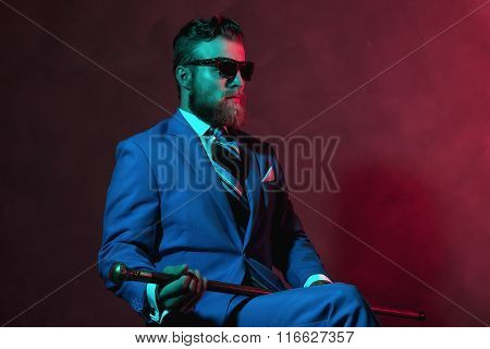 Stylish Gentleman With A Cane And Sunglasses
