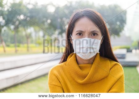 Asian woman wearing a face mask