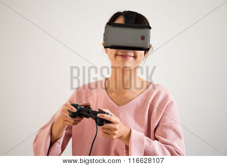Woman play video game with virtual reality goggle