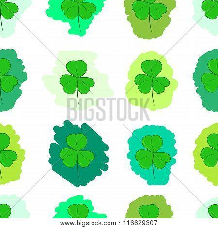 Seamless green painted shamrocks