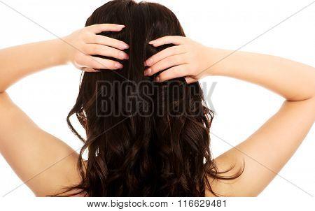 Beautiful woman touching her hair.