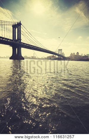Retro Stylized Manhattan Bridge Against Sun, Nyc, Usa