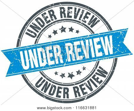Under Review Blue Round Grunge Vintage Ribbon Stamp