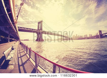 Vintage Stylized Fisheye Lens Photo Of Bench At Hudson River Bank And Manhattan Bridge, Nyc.