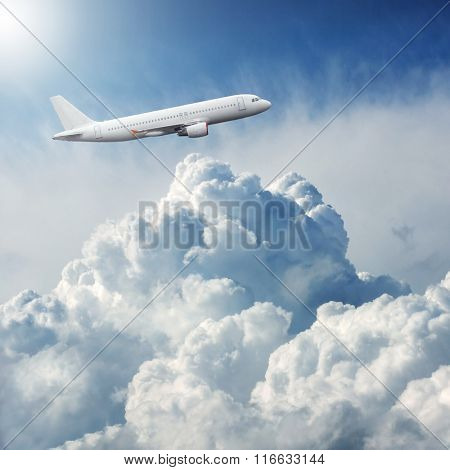 Plane flying in the sky through dramatic storm clouds