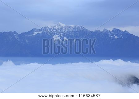 beautiful  clouds waterfall and frozen mountain summits