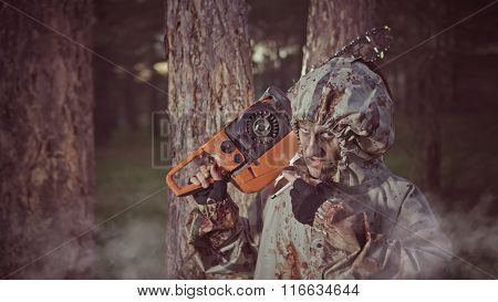 Smoking Maniac With The Chainsaw Dressed In A Dirty Bloody Raincoat