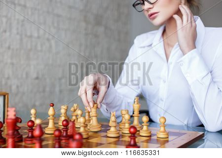 Clever Woman Moving With Queen On Chessboard
