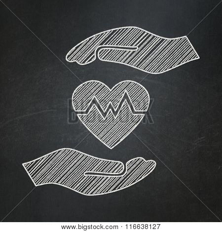 Insurance concept: Heart And Palm on chalkboard background