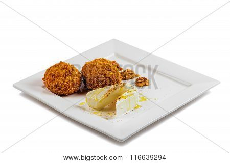 Delicious restaurant dessert with  scoops of fried ice cream covered with a crispy crust, served wit