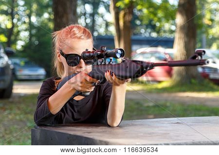 Cool Blond In Sun Glasses Aiming From Telescopic Gun