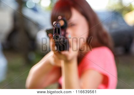 Young Woman Shooting From Telescopic Air Gun, Focus On Front Sight