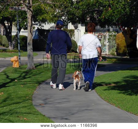Couple Walking Their Dog