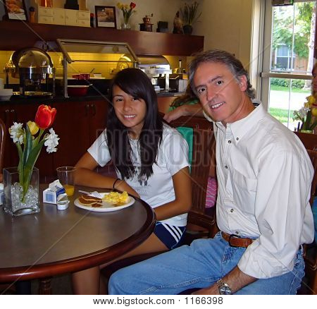 Father And Daughter At Breakfast