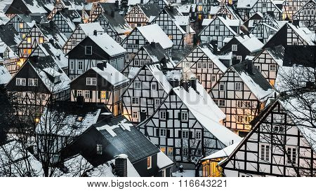 Winter village with snow covered roofs