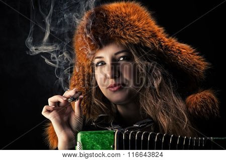 portrait beautiful woman in fur hat with a cigarette in hand