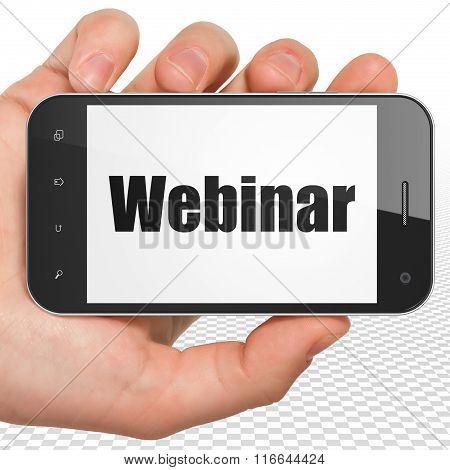 Education concept: Hand Holding Smartphone with Webinar on display