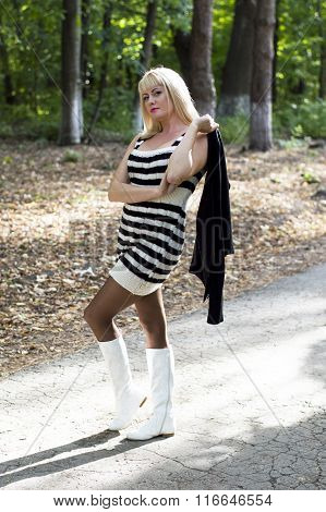 The Beautiful Blonde In White Boots Walks In Park