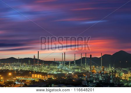 Twilight Of Oil Refinery Plant On Blur Skies Background.