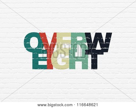 Health concept: Overweight on wall background