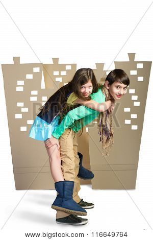 Love concept. boy holding the girl on background of cardboard city. isolate white