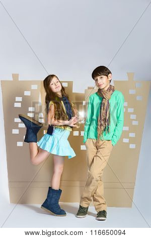Love concept. smiling boy and happy girl standing on background of cardboard city